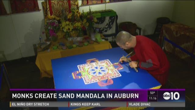 Monks create sand mandala in Auburn