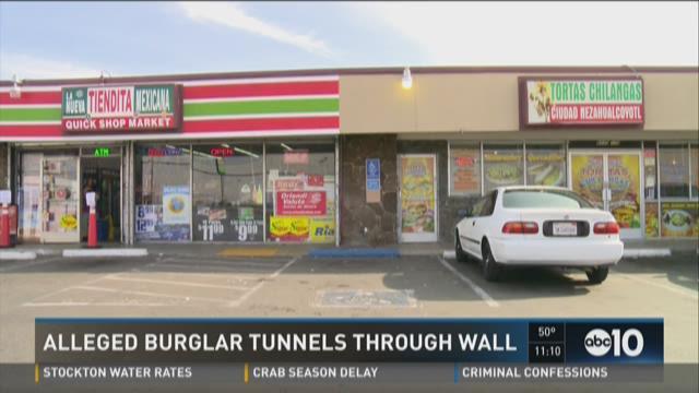 Alleged burglar tunnels through wall