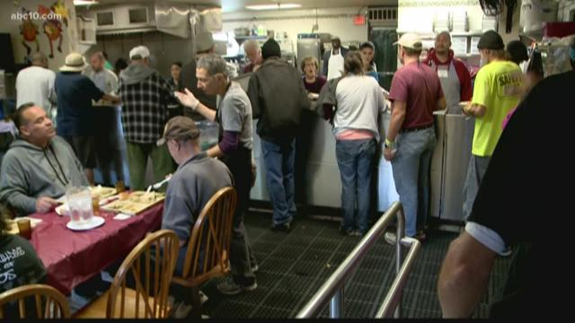Loaves and fishes holds annual thanksgiving feast in for Loaves and fishes sacramento