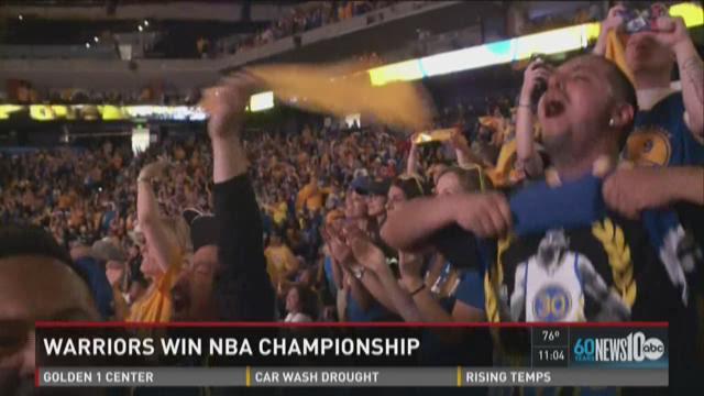 Fans in Oakland celebrate Warriors' win