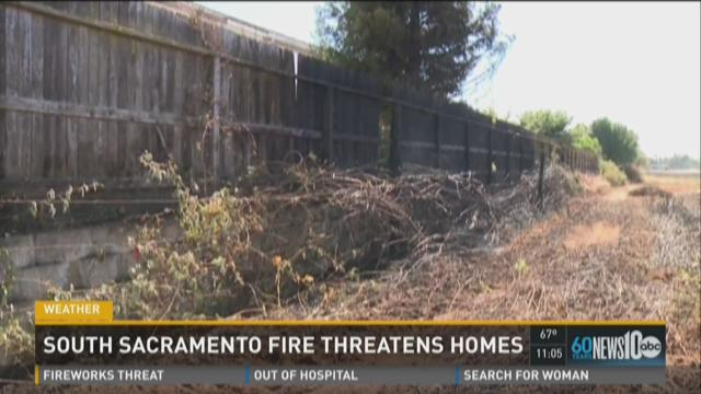 South Sacramento home threatens homes