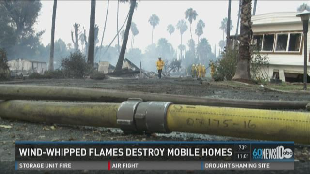 Wind-whipped flames destroy mobile homes